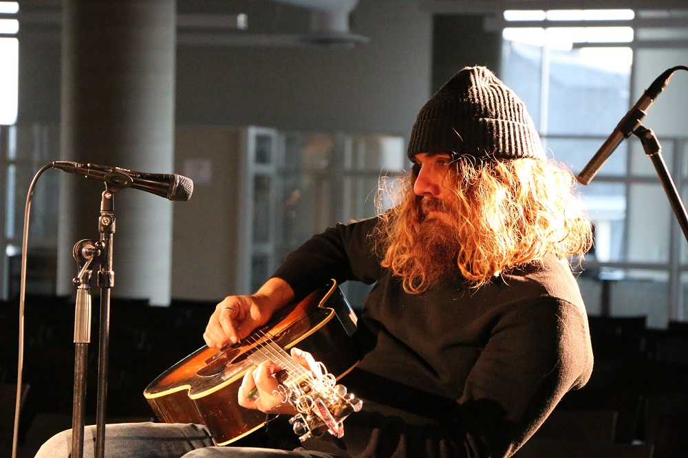 Photo of Tom Wilson doing a sound check before the Blackie and the Rodeo Kings concert