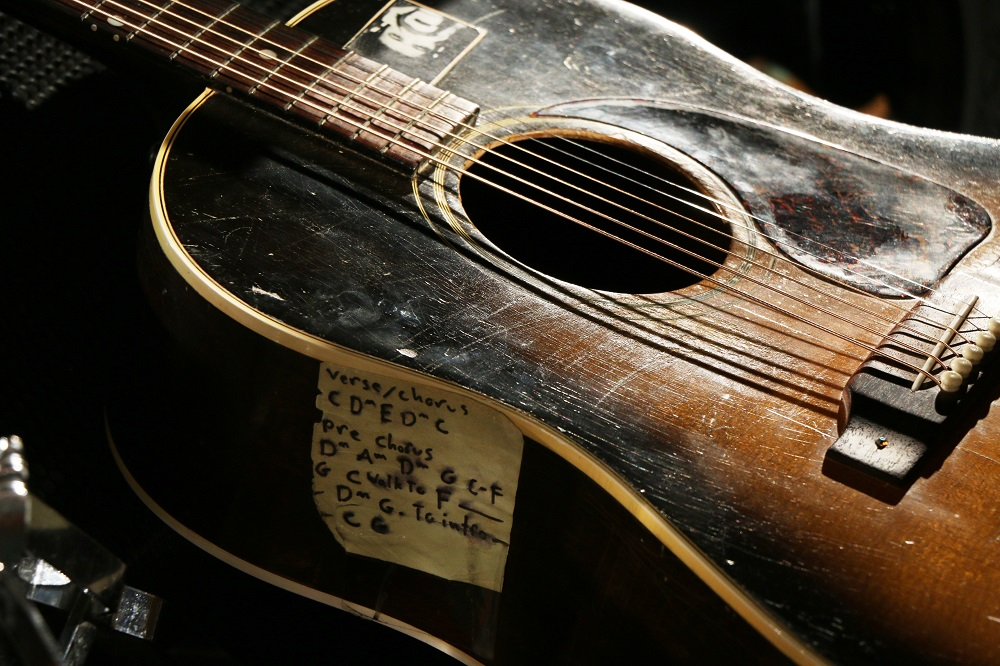 Closeup of Tom Wilson's guitar at the Blackie and the Rodeo Kings concert
