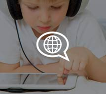 Graphic of a boy using a tablet with a speech bubble icon