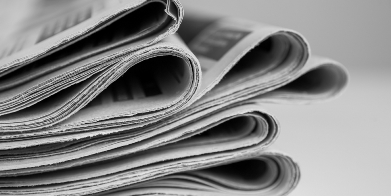 Closeup of a stack of newspapers