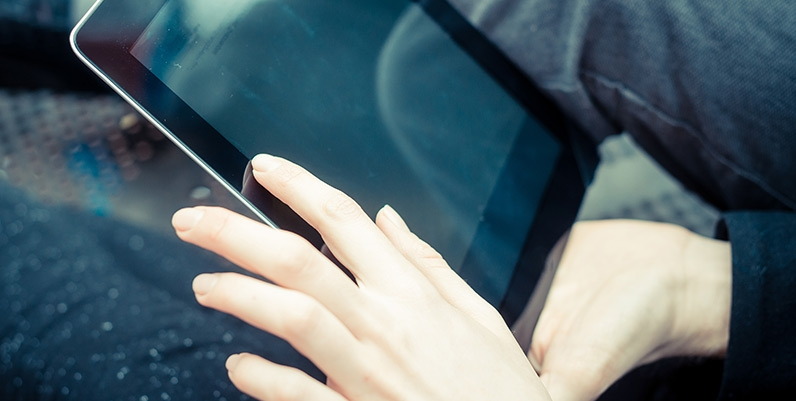 Closeup of hands holding a tablet