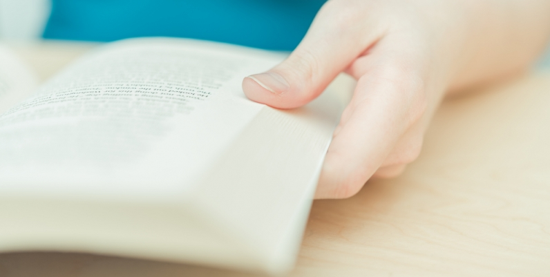 Closeup of a woman holding a book