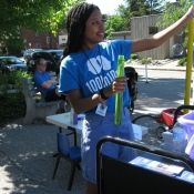 HPL staff member making bubbles outside during 100In1Day event