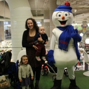 A family poses for a picture with Chimo the snowman