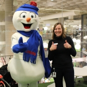 Chimo the snowman and HPL staff member give three thumbs up