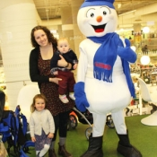 mother with babies and a snowman mascot