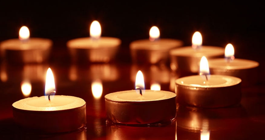 photo of candles in a dark room